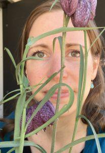 Judith behind Fritillaria flowers