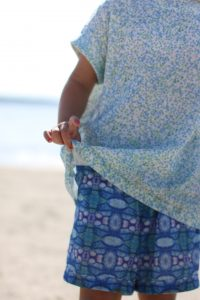 Linen hummingbird tunic and trousers in cypress and poppy pattern