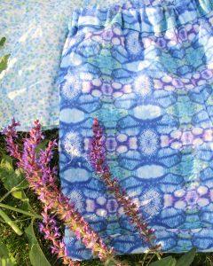Linen fabric in hummingbird trousers in blue poppy pattern